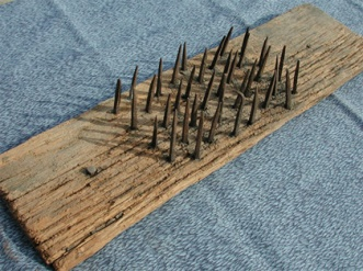 board with nails one